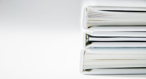 White binders representing old school accounting methods - now we have Microsoft 365 - Inderly IT (Toronto IT support services)