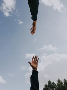 Two hands reaching towards each other - representing data recovery page (Inderly IT - Toronto support services)